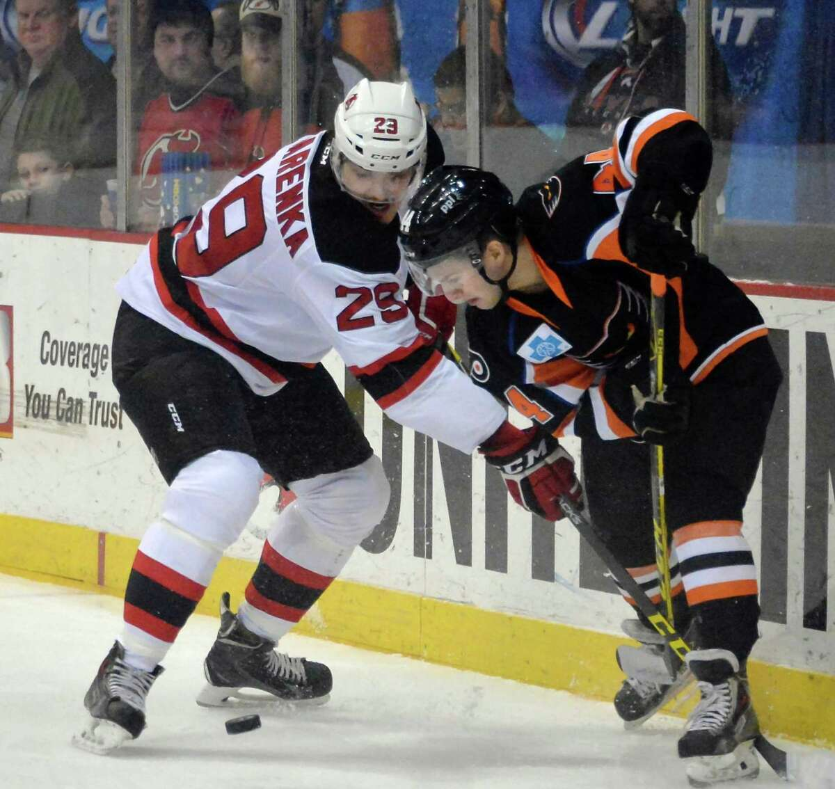 Albany Devils' #29 Raman Hrabarenka, left, and Lehigh Valley Phantoms' # 44 Joe Rehkamp vie for the puck during Saturday's game at the Times Union Center Jan. 9, 2016 in Albany, NY. (John Carl D'Annibale / Times Union)