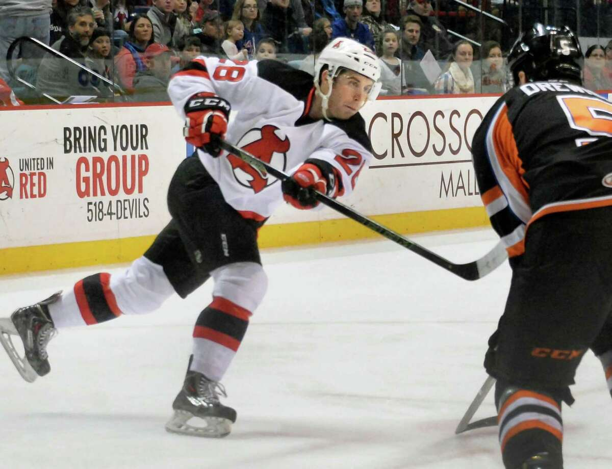 Albany Devils' #28 Matt Lorito, left, gets off a shot on goal during Saturday's game against the Lehigh Valley Phantoms at the Times Union Center Jan. 9, 2016 in Albany, NY. (John Carl D'Annibale / Times Union)