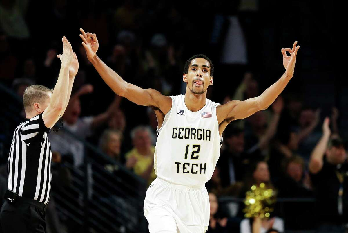 Georgia Tech's Quinton Stephens celebrates after hitting a three-point basket in the first half of an NCAA college basketball game against Virginia Saturday, Jan. 9, 2016, in Atlanta. (AP Photo/David Goldman) ORG XMIT: GADG104