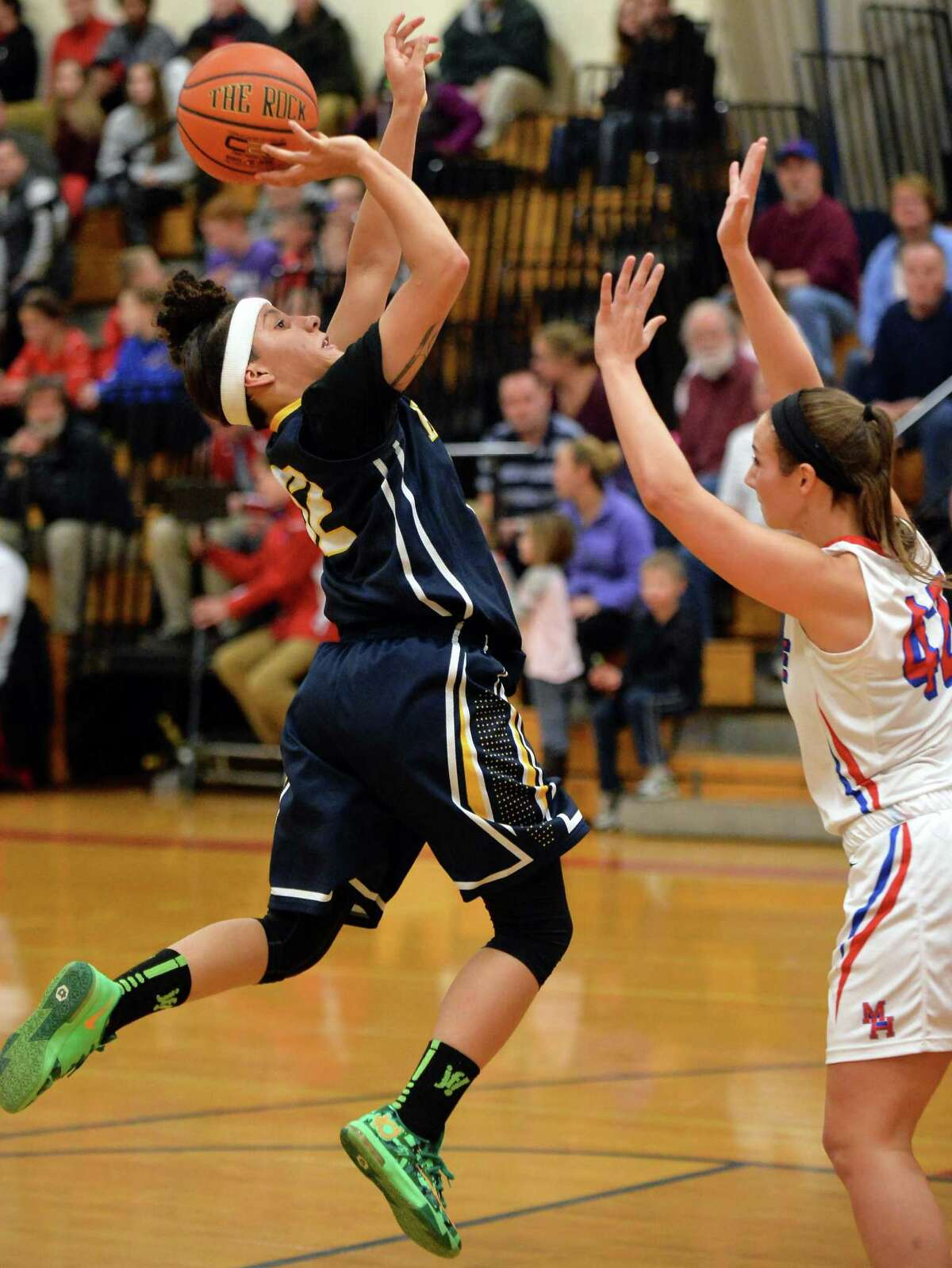 Hudson's #12 Selena Jones, left, goes to the basket as Maple Hill's #42 Kayla Hanrahn defends during Saturday's game Jan. 9, 2016 in Castleton, NY. (John Carl D'Annibale / Times Union)