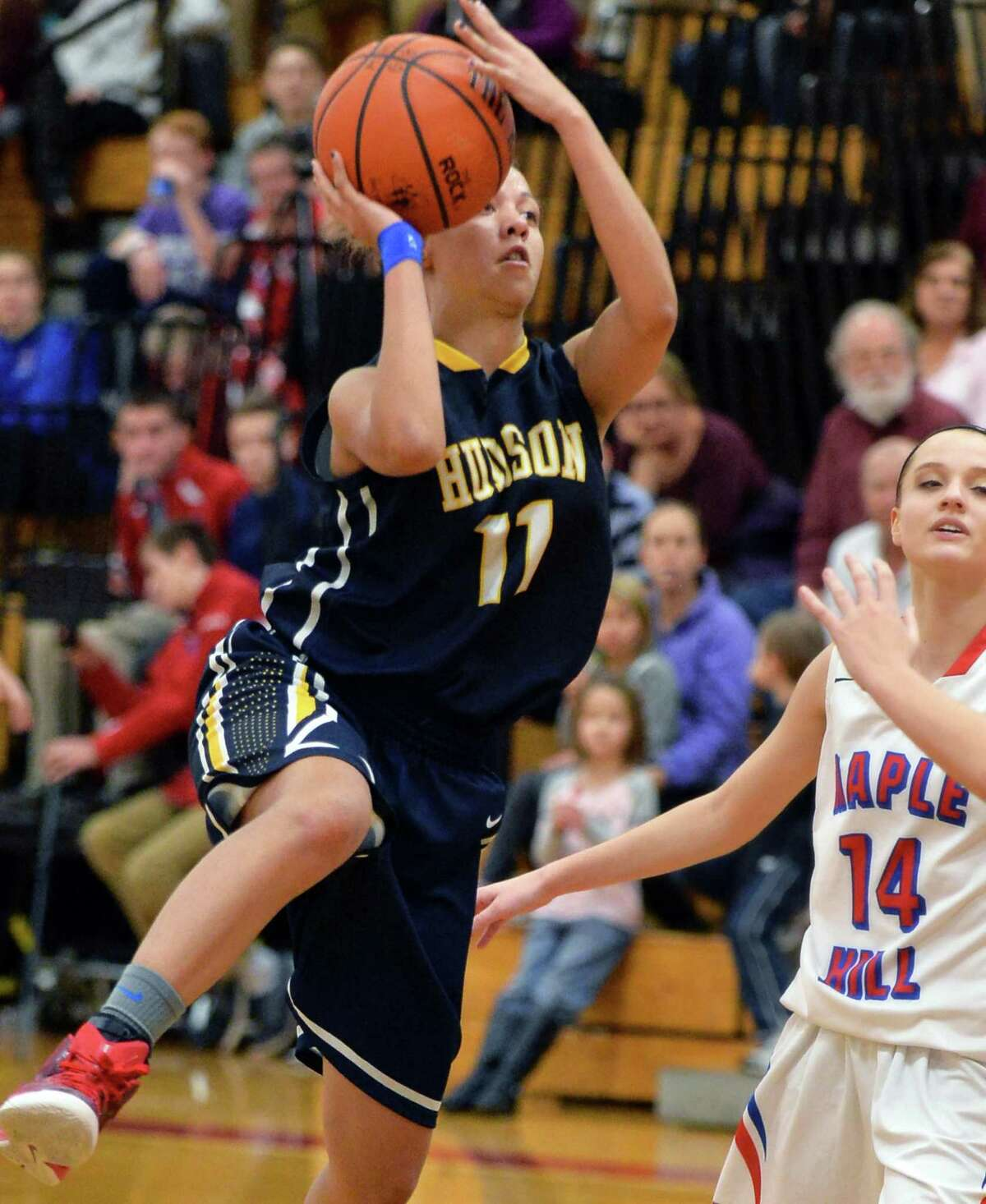 Hudson's #11 Jasmyne Peck, left, goes to the hoop during Saturday's game against Maple Hill Jan. 9, 2016 in Castleton, NY. (John Carl D'Annibale / Times Union)
