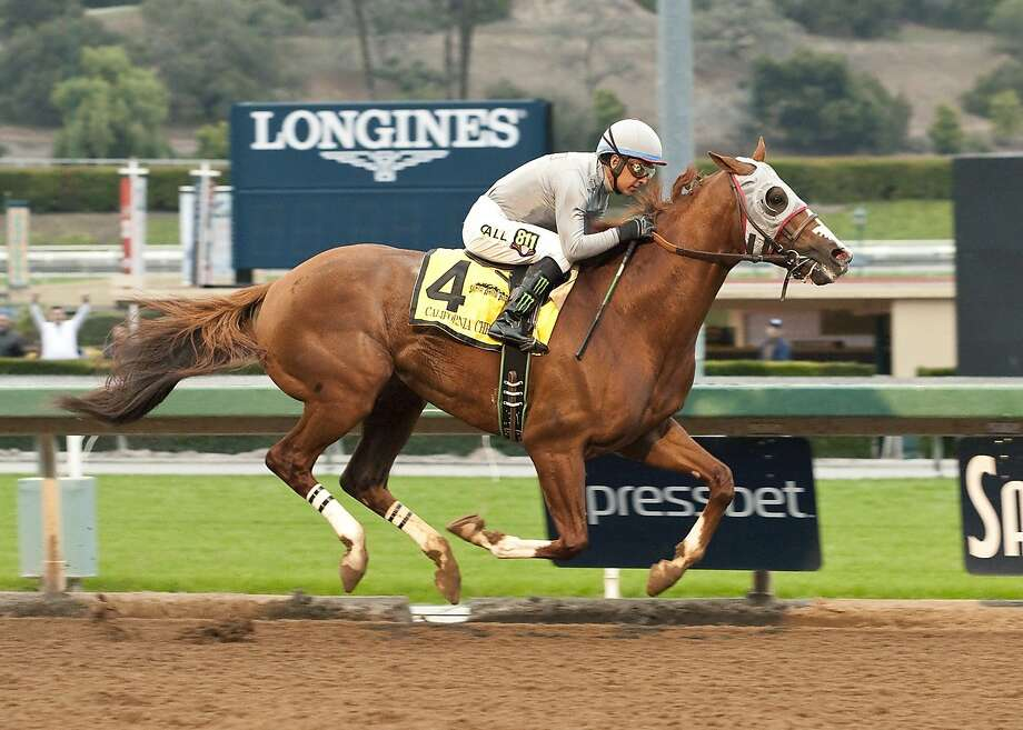 California Chrome and jockey Victor Espinoza win the Grade II, $200,000 San Pasqual Stakes on Saturday at Santa Anita. It was the 2014 Kentucky Derby winner's first race since March. Photo: Associated Press