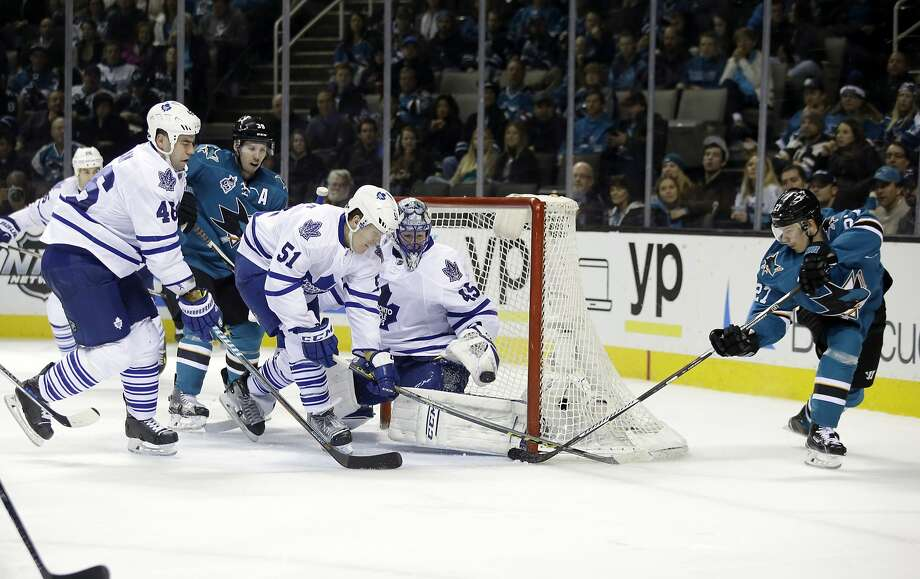 Joonas Donskoi (27) slips the puck past Toronto goalie Jonathan Bernier in the third period. Donskoi's fifth goal of the season gave the Sharks a 6-0 lead in a game that was scoreless after one period. Photo: Marcio Jose Sanchez, Associated Press