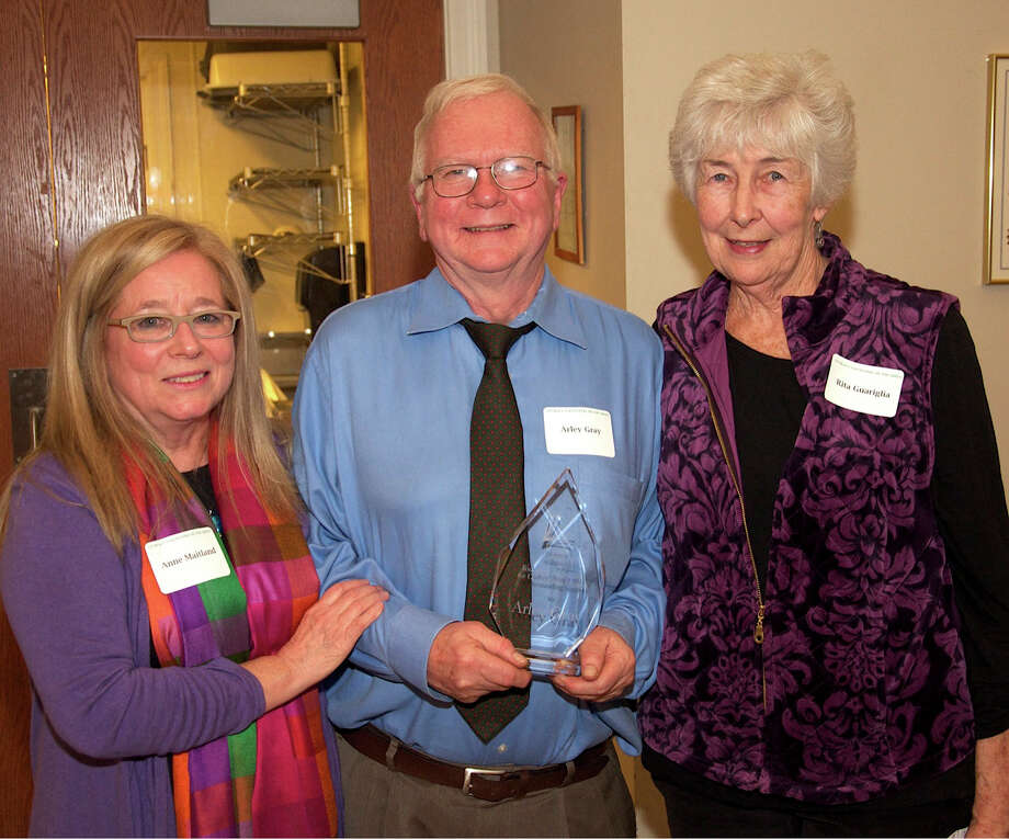 Literacy Volunteers on the Green in New Milford recently celebrated the Thanksgiving holiday with its annual dinner. Above, Anne Maitland, left, and Rita Guariglia, who established LVG in 2005, congratulate Arley Gray of New Milford as recipient of this year's LVG Founders' Award, presented at the dinner Nov. 19. Photo: Courtesy Of Literacy Volunteers On The Green / The News-Times Contributed