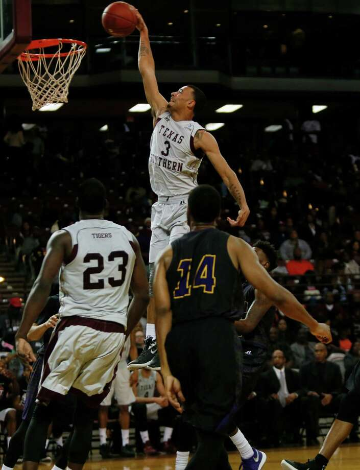 Texas Southern's David Blanks goes up for two of his nine points against Prairie View A&M's Zachary Hamilton in Saturday's SWAC showdown at H&PE Arena. Photo: Marie D. De Jesus, Staff / © 2016 Marie D. De Jesus