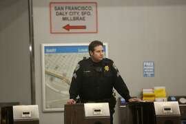 BART Police Sgt. Martinez stands at the kiosks of the closed West Oakland BART station, the closest stop where there was a fatal shooting on a BART train Jan. 9, 2015 in Oakland, Calif.