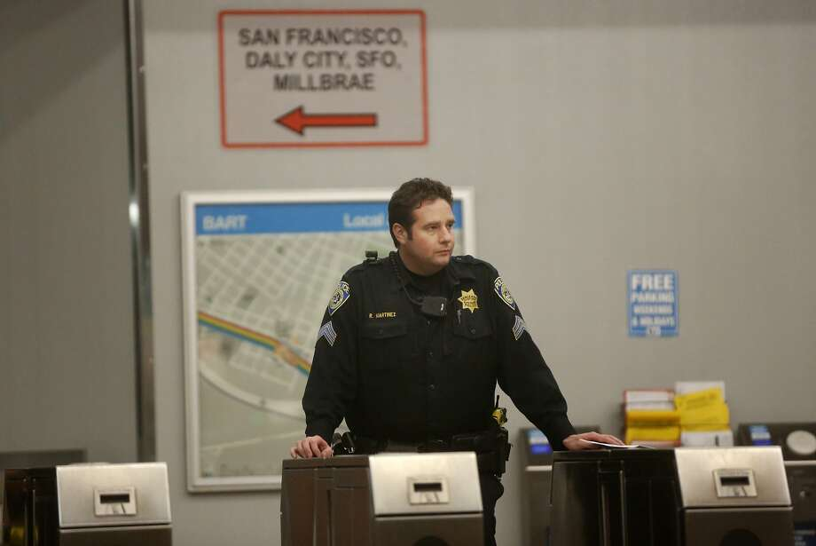 BART Police Sgt. Martinez stands at the kiosks of the closed West Oakland BART station, the closest stop where there was a fatal shooting on a BART train Jan. 9, 2015 in Oakland, Calif. Photo: Leah Millis, The Chronicle