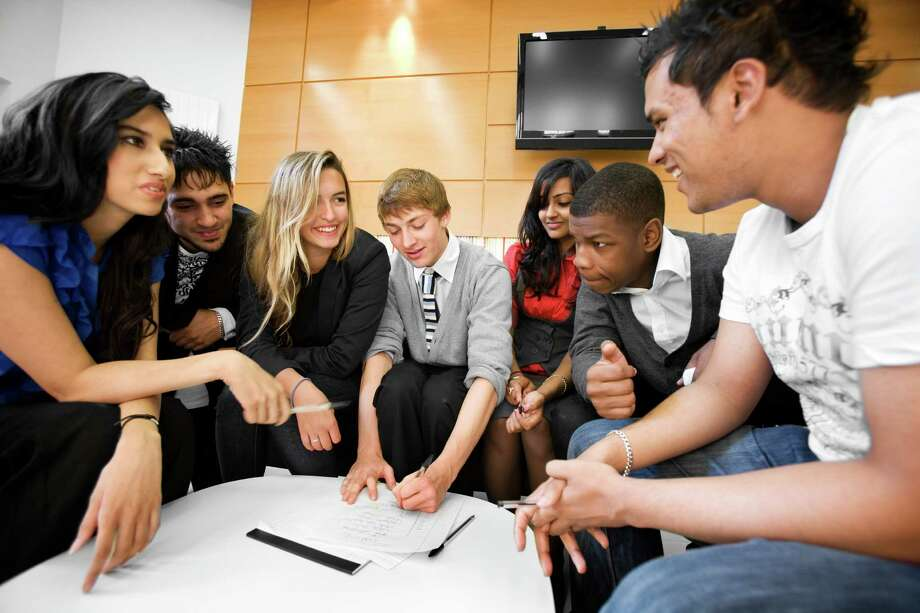 "John Boyega feigning interest in a stock photo called ""further education: teenage teamwork."" Photo: Chris Schmidt, Chris Schmidt/Getty Images / (c) Chris Schmidt"