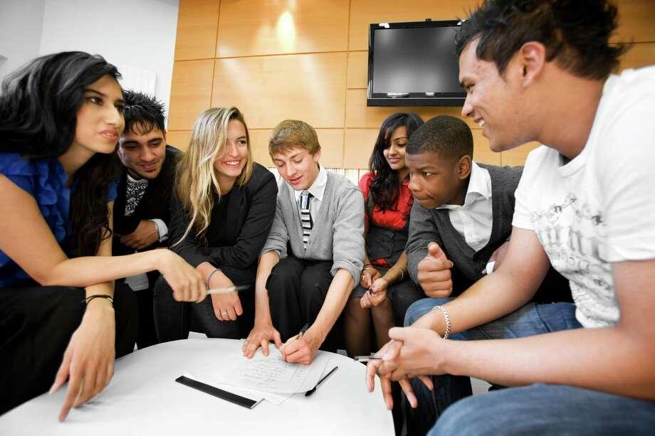 "John Boyega feigning interest in a stock photo called ""further education: teenage teamwork."" Photo: Chris Schmidt, Chris Schmidt/Getty Images / (c) Chris Schmidt"