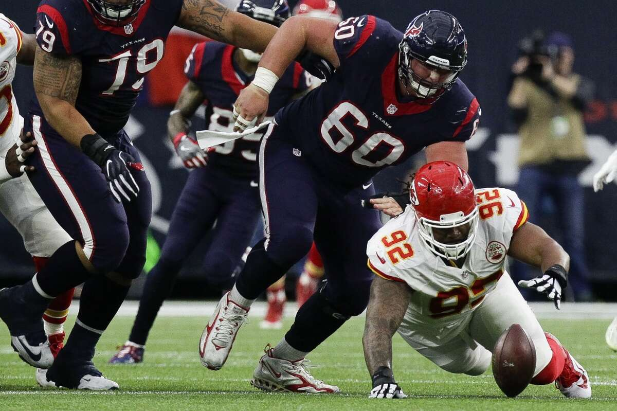 Kansas City Chiefs defensive end Dontari Poe (92) recovers a fumble by Houston Texans quarterback Brian Hoyer (7) during the first quarter of the AFC Wildcard playoff game at NRG Stadium Saturday, Jan. 9, 2016, in Houston. ( Michael Ciaglo / Houston Chronicle )