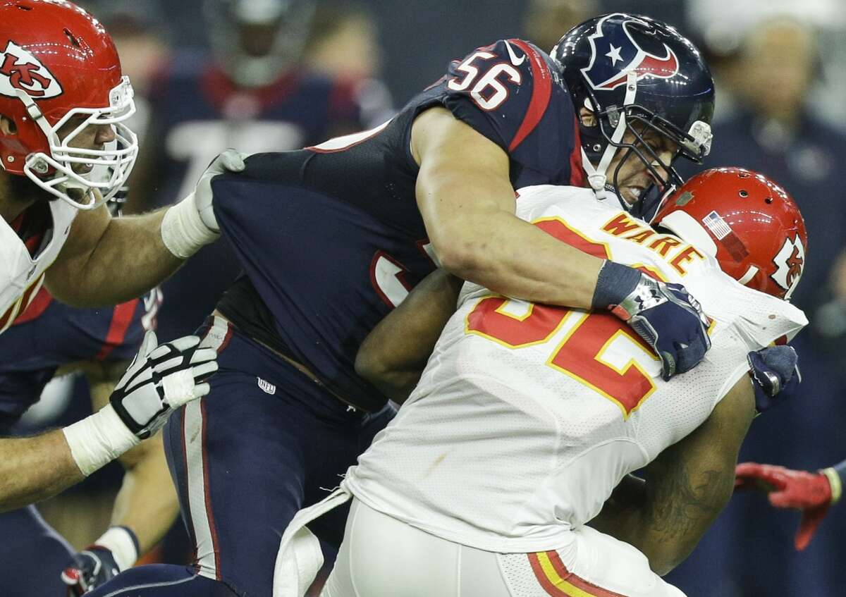 Houston Texans inside linebacker Brian Cushing (56) tackles Kansas City Chiefs running back Spencer Ware (32) during the third quarter of the AFC Wildcard playoff game at NRG Stadium on Saturday, Jan. 9, 2016, in Houston. ( Brett Coomer / Houston Chronicle )