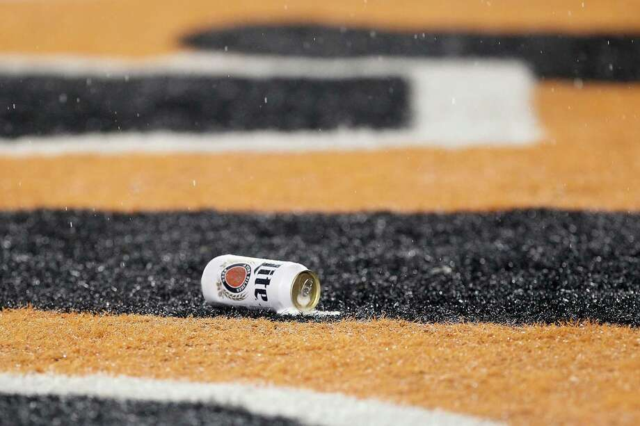 CINCINNATI, OH - JANUARY 09:  A can of beer is seen in the end zone after being thrown onto the field by a fan during the AFC Wild Card Playoff game between the Cincinnati Bengals and the Pittsburgh Steelers at Paul Brown Stadium on January 9, 2016 in Cincinnati, Ohio. Photo: Dylan Buell, Getty Images / 2016 Getty Images