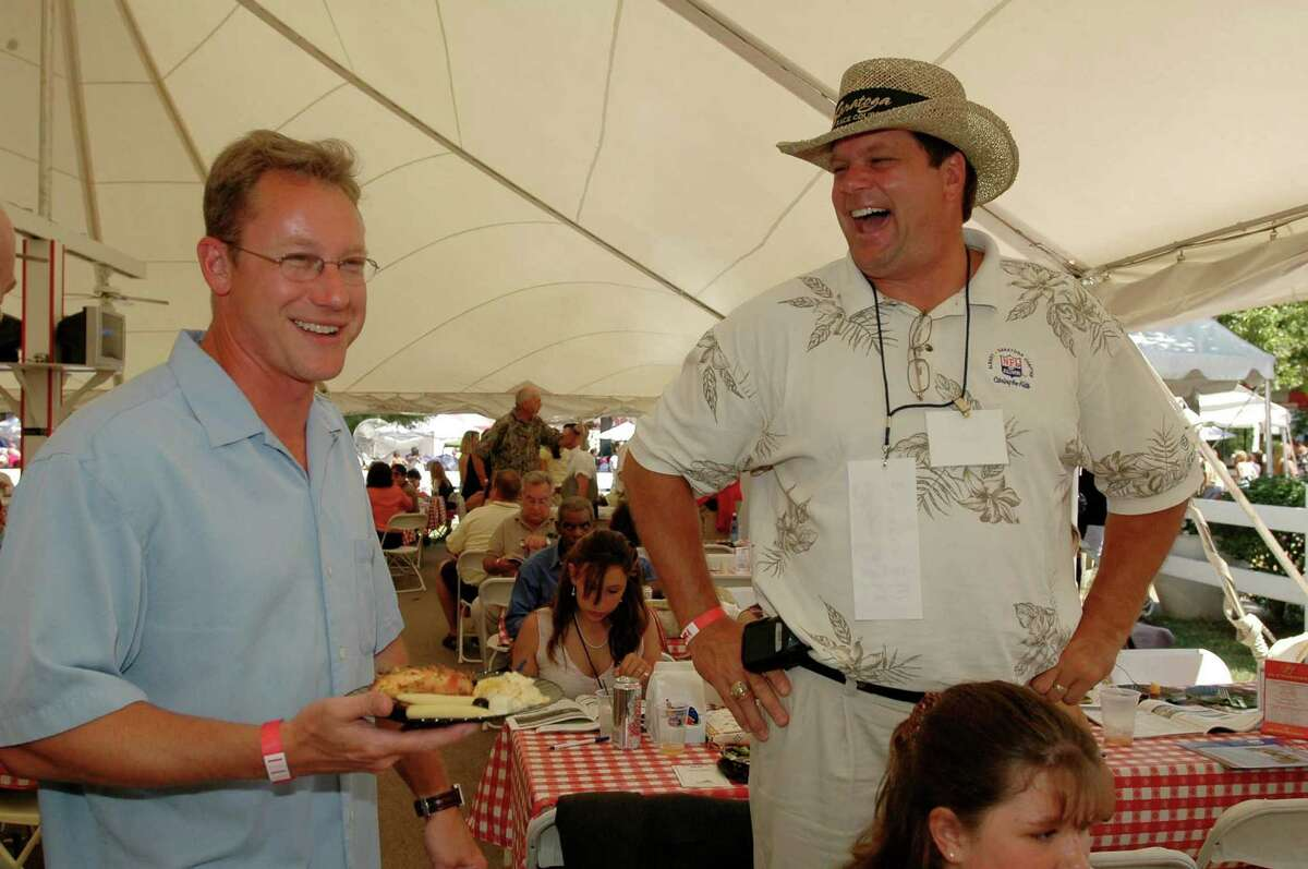 TIMES UNION STAFF PHOTO BY: LUANNE M. FERRIS--Sunday, August 7, 2005, Saratoga Springs, NY, L-R: Bob Dasch, of Canandagua, shares a laugh with NFL alumni Tim Sherwin, a former Indianapolis Colt, at the Paddock tent at the Saratoga Flat Track, at the 12th annual NFL Legends at the Race Course. (sp. corr.) Sherwin's 29-year-old son, Brandon, was killed Jan. 8, 2016 in what police describe as a dispute with a neighbor in Watervliet.