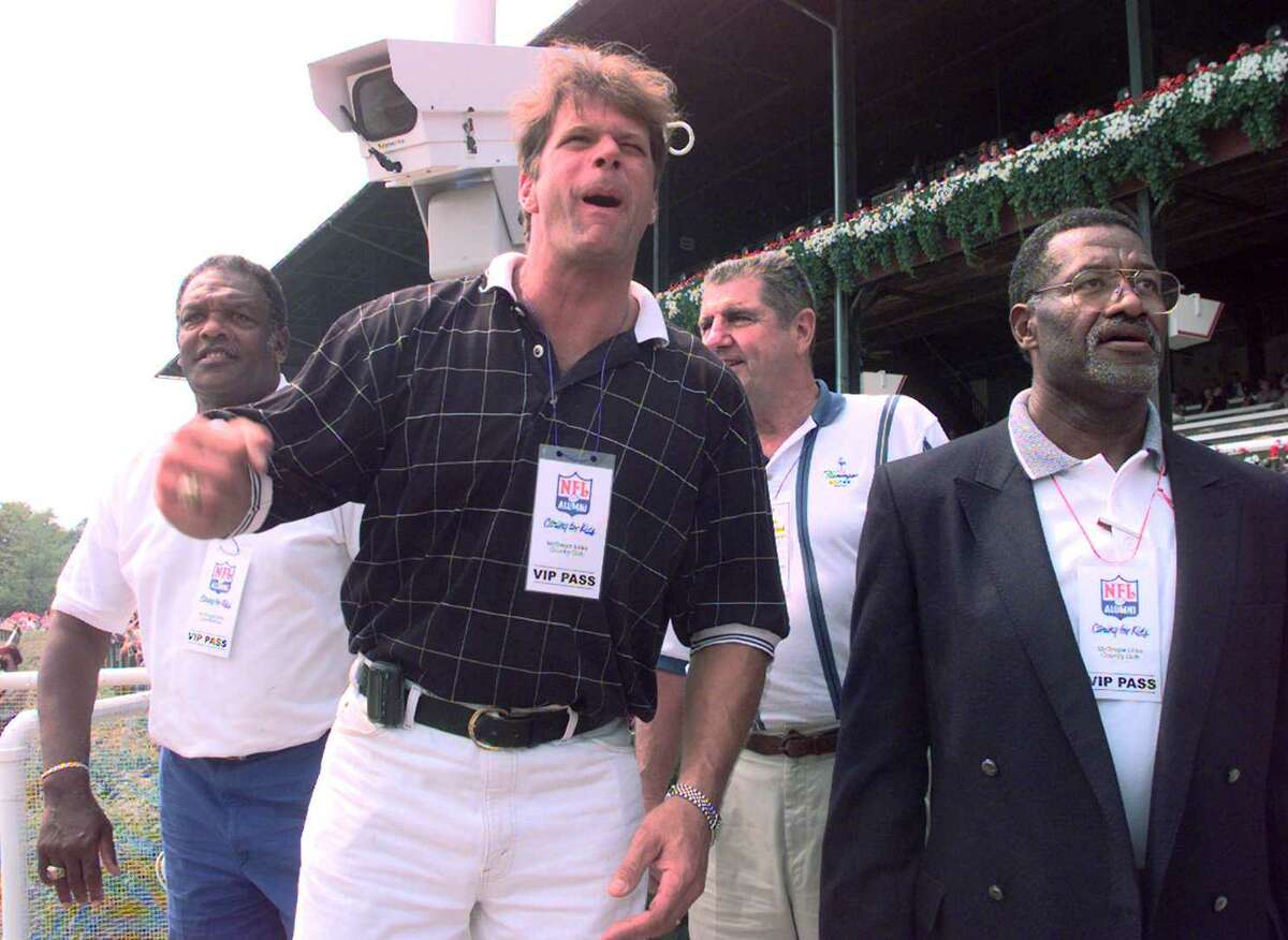 TIMES UNION PHOTO-- SKIP DICSKTEIN -- MONDAY AUGUST 11, 1997 -- SARATOGA SPRINGS -- FORMER PRO FOOTBALL PLAYER TIM SHERWIN OF THE COLTS AND THE NY GIANTS AND A NATIVE OF WATERVLIET EARL MORRALL FORMERLY OF THE NY GIANTS, BOBBY BELL FORMERLY OF THE KC CHIEFS AND ON THE FAR LEFT OF THE IMAGE LENNY MORE OF THE COLTS ENJOY THE THIRD RACE A SARATOGA. SHERWIN HAD THE WINNER. #3, DIAMOND ON THE RUN RIDDEN BY ROBBIE DAVIS.