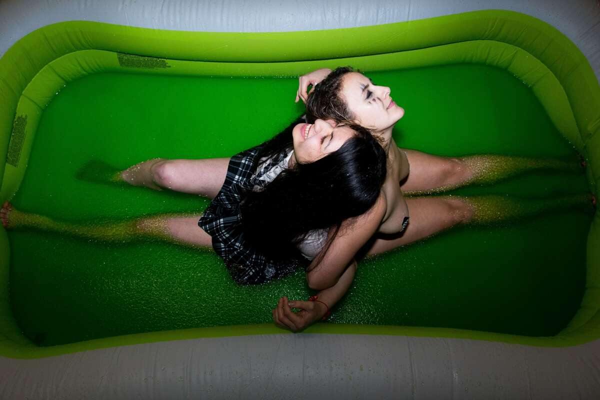 Sailor Doom and Brawnhilda prepare to wrestle in a pool of green jello at Jello Underground at Evlov Fitness in South Lake Union on Friday, Jan. 9, 2016. (Grant Hindsley, seattlepi.com) Jello wrestlers took to a pool of green jello to fight for honor at Evolv Fitness in South Lake Union on Friday, Jan. 9, 2015. The group returned after a two year hiatus. The event welcomes all but celebrates being an all-female wrestling show, the only of its kind on the West Coast. Fans are expected to cheer, yell, enjoy beers and jello shots and even participate in the now monthly event.