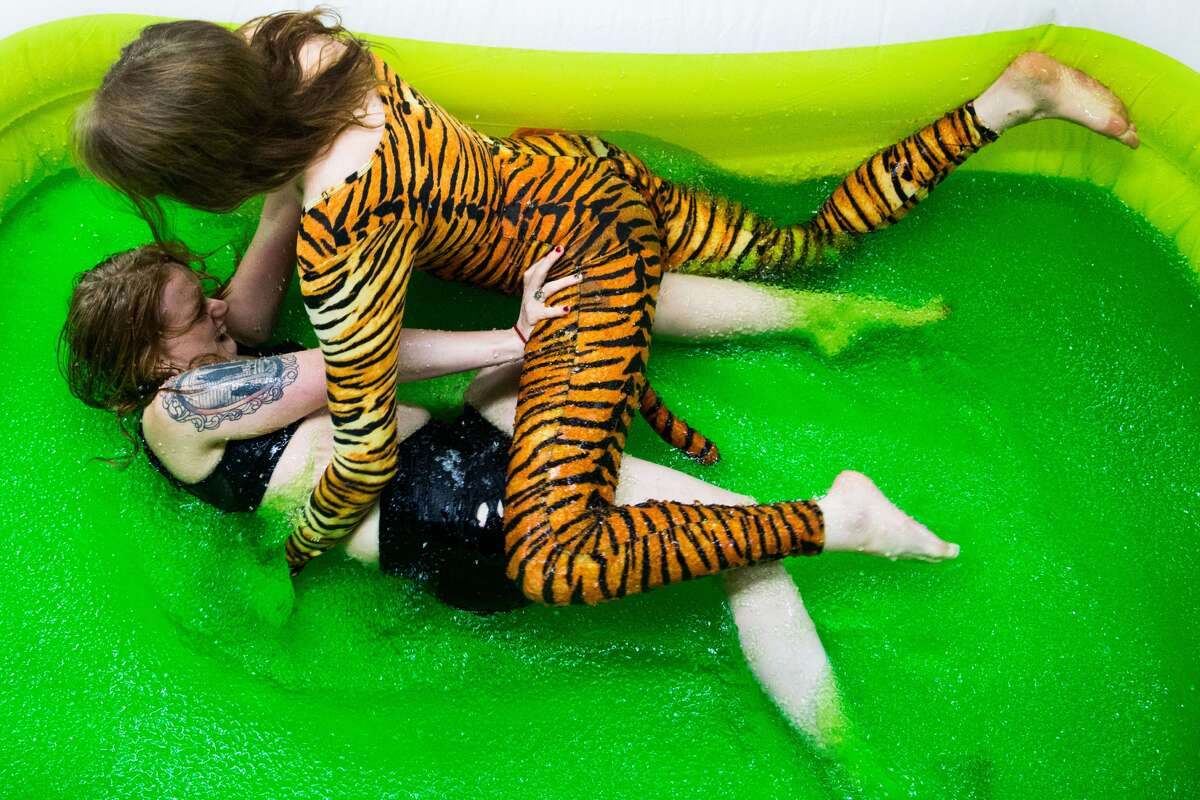Reigning champion Gingersnaps, bottom, is pinned by Tiga, the soon-to-be jello wrestling champion, at Jello Underground at Evlov Fitness in South Lake Union on Friday, Jan. 9, 2016. (Grant Hindsley, seattlepi.com)