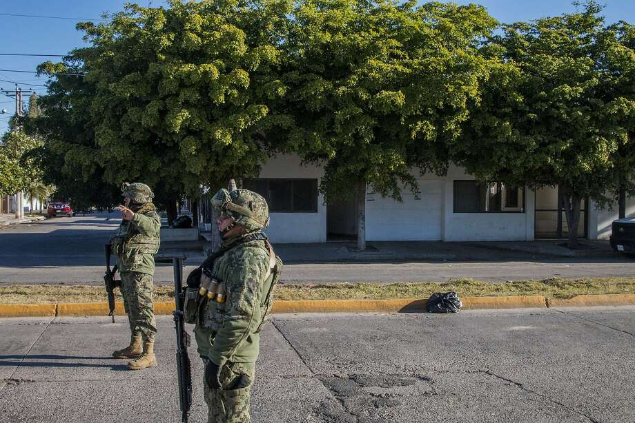 """Special forces guard the house in Los Mochis where Joaquin """"El Chapo"""" Guzman last sought refuge. Photo: Hector Guerrero, AFP / Getty Images"""