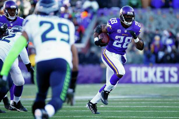 Minnesota Vikings running back Adrian Peterson runs the ball in Sunday's NFC wild card game in Minneapolis