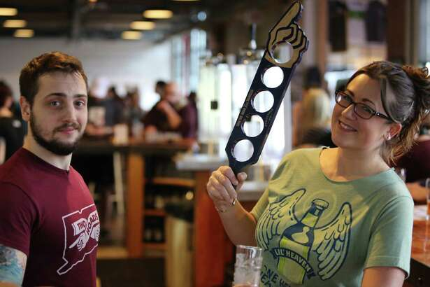 "Two Roads Brewery in Stratford hosted ""Poses 2 Pints,"" a yoga and beer tasting event on January 10, 2016. Were you SEEN?"