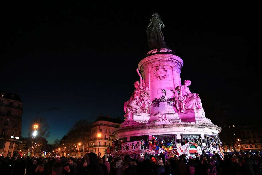 The Place de la Republique, a symbol of solidarity, is bathed in red light after a ceremony to mark the first anniversary of the Charlie Hebdo and supermarket terror attacks in Paris. Photo: Thibault Camus, Associated Press