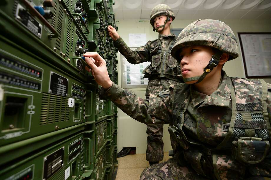 South Korean soldiers adjust audio equipment used to broadcast propaganda across the border with North Korea. The broadcasts resumed Friday. Photo: Lim Tae-hoon, Associated Press