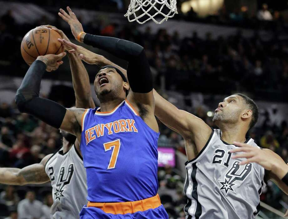 New York Knicks forward Carmelo Anthony (7) is fouled by San Antonio Spurs center Tim Duncan (21) as he drives to the basket during the first half of an NBA basketball game Friday, Jan. 8, 2016, in San Antonio. (AP Photo/Eric Gay) Photo: Eric Gay, STF / Associated Press / AP