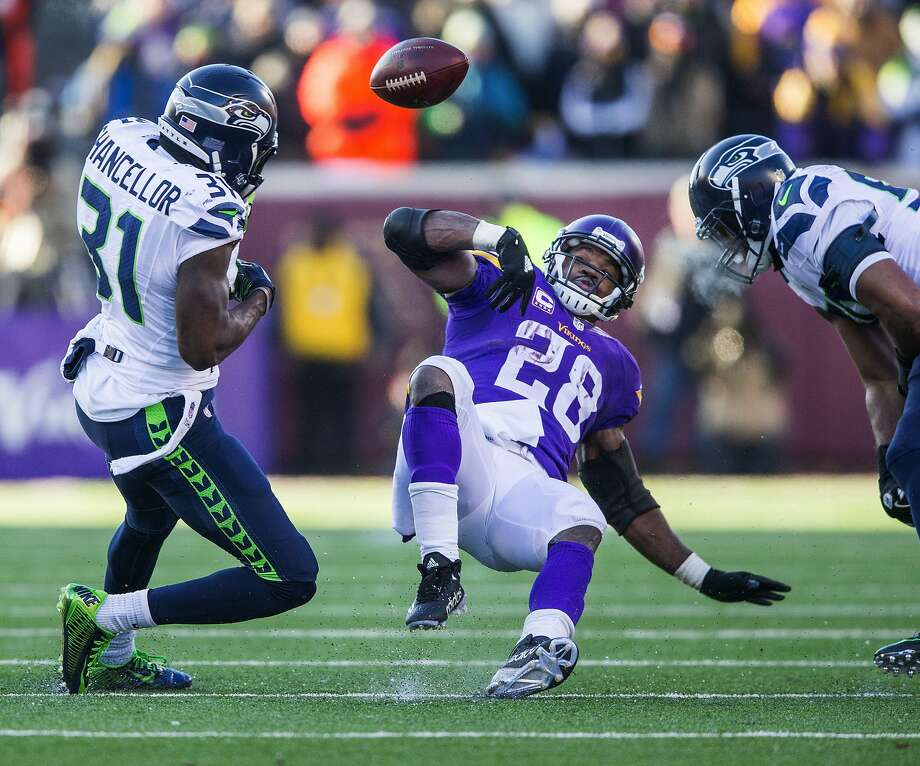 The Seahawks' Kam Chancellor stripped the ball from Vikings running back Adrian Peterson (center) with 10:37 remaining in the fourth quarter, leading to Seattle's go-ahead field goal. Photo: Dean Rutz, McClatchy-Tribune News Service