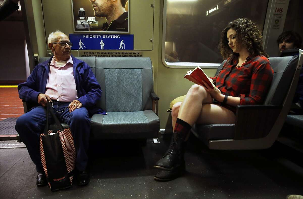 Ashleigh Plasterer reads a book during No Pants! Subway Ride 2016 in San Francisco, Calif., on Sunday, January 10, 2016.