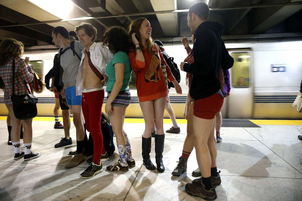 No Pants! Subway Ride 2016 participants wait to board a train at Embarcadero station in San Francisco, Calif., on Sunday, January 10, 2016.