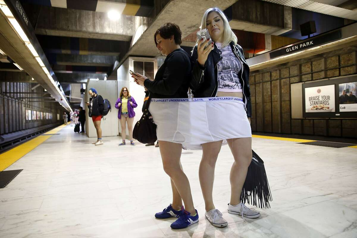 Jen Kirchhofer (left) and Kristina Banks wait for a BART train at the Glen Park station during No Pants! Subway Ride 2016 in San Francisco, Calif., on Sunday, January 10, 2016.