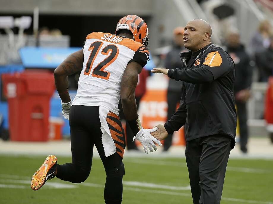 Cincinnati Bengals offensive coordinator Hue Jackson, right, greets wide receiver Mohamed Sanu (12) before an NFL football game against the San Francisco 49ers in Santa Clara, Calif., Sunday, Dec. 20, 2015. (AP Photo/Eric Risberg) Photo: Eric Risberg, Associated Press