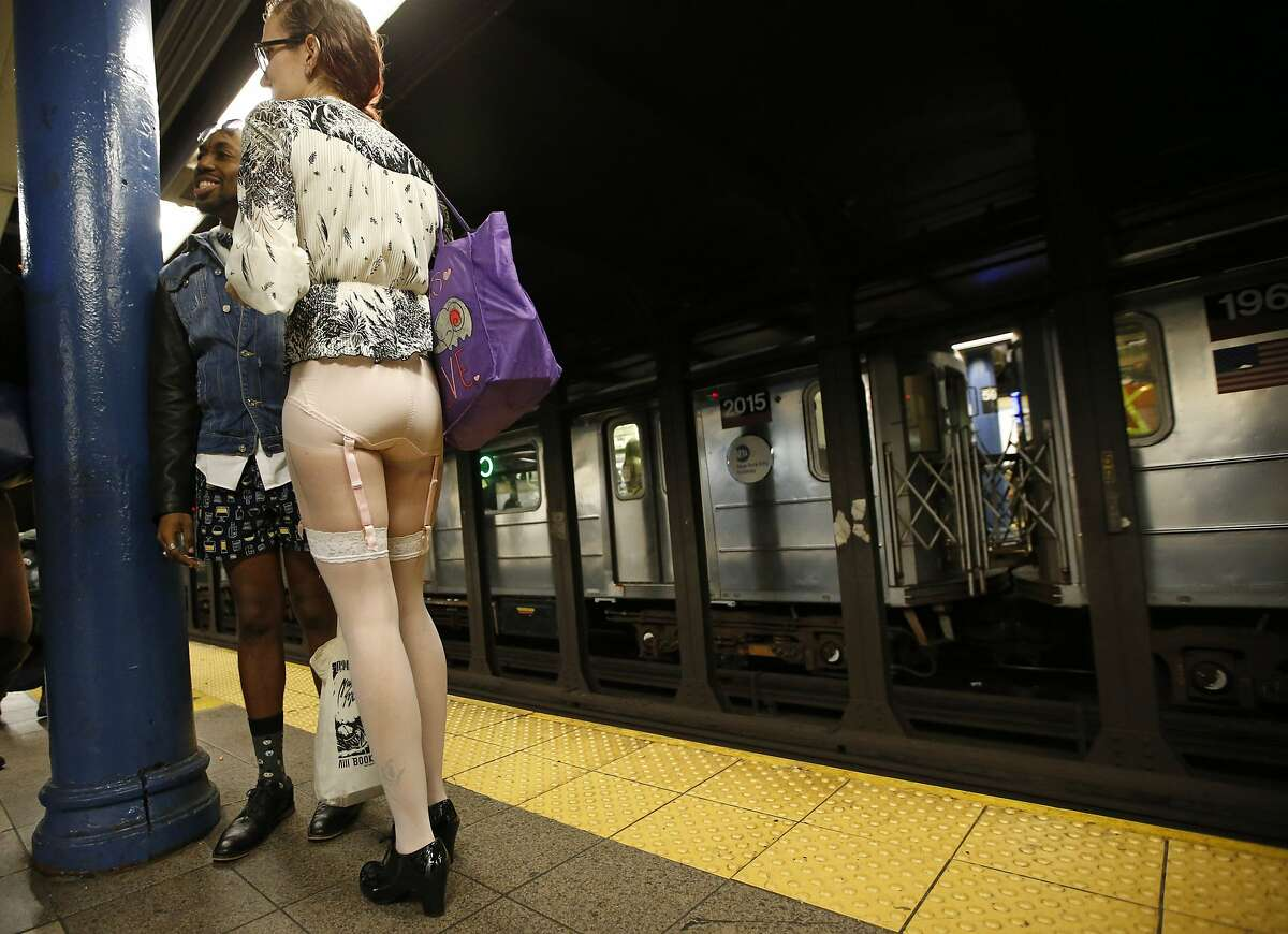 A man in boxer shorts and a woman wearing hosiery with a garter belt wait for a train at a Manhattan train station during the 15th annual No Pants Subway Ride Sunday, Jan. 10, 2016, in New York. The group event, meant as a prank to amuse unsuspecting subway riders, has been going on since 2002. (AP Photo/Kathy Willens)