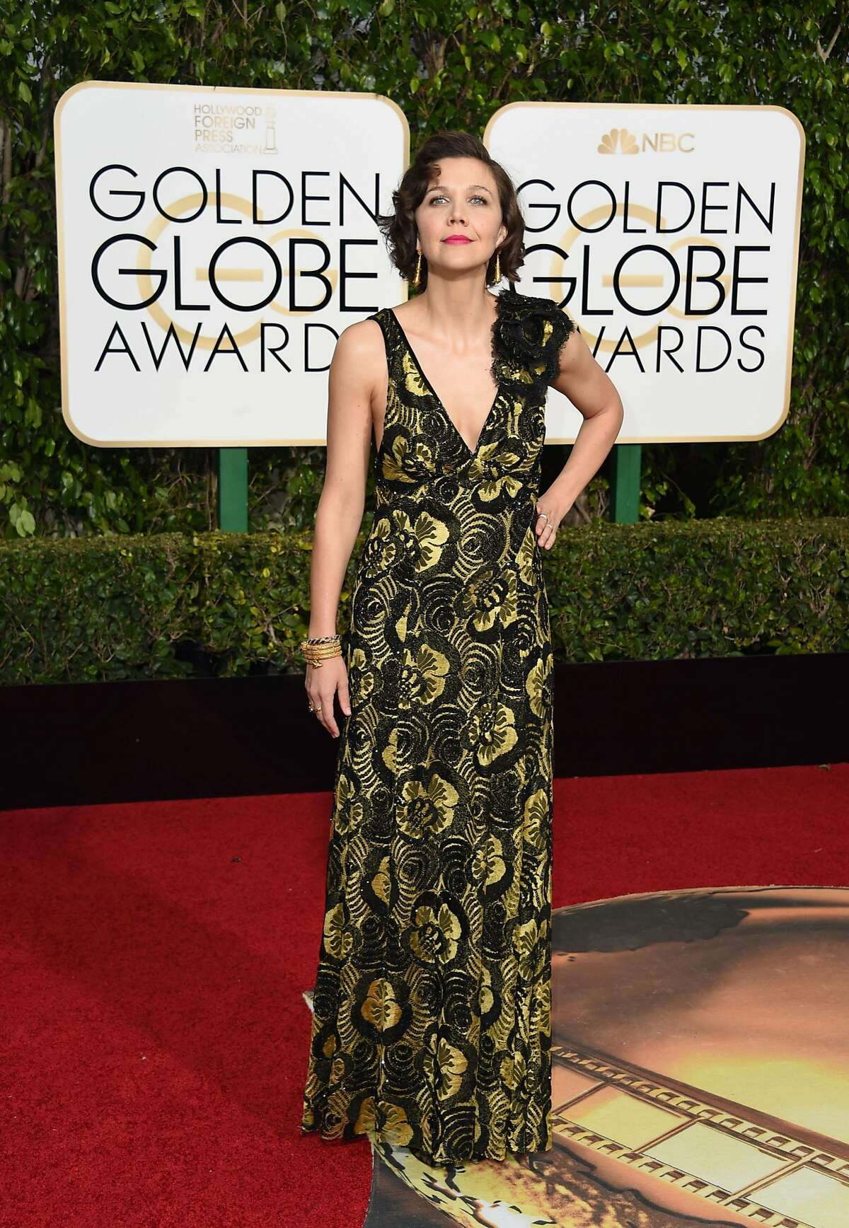 Actress Maggie Gyllenhaal arrives for the 73nd annual Golden Globe Awards, January 10, 2016, at the Beverly Hilton Hotel in Beverly Hills, California.