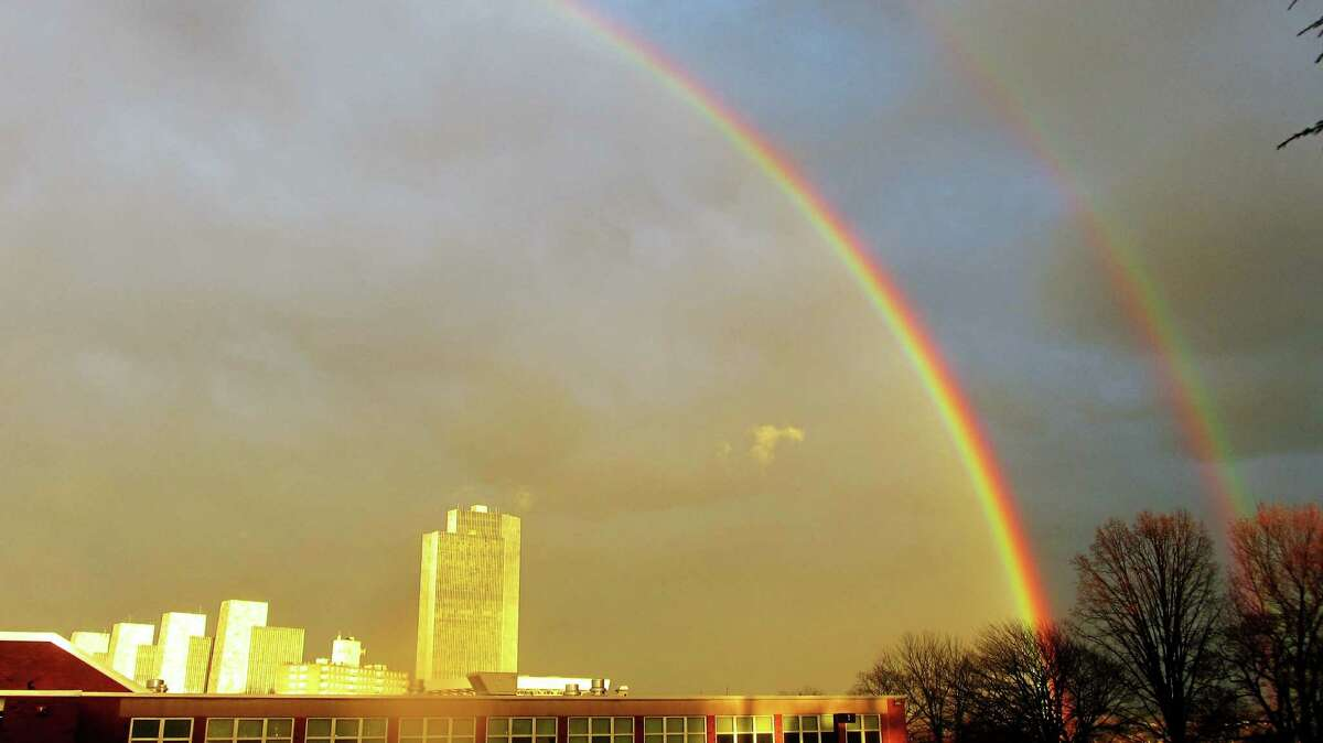 A double rainbow appears over Sunday afternoon, on a day which reached a record-setting 55 degrees. Photo by Bob Gardinier