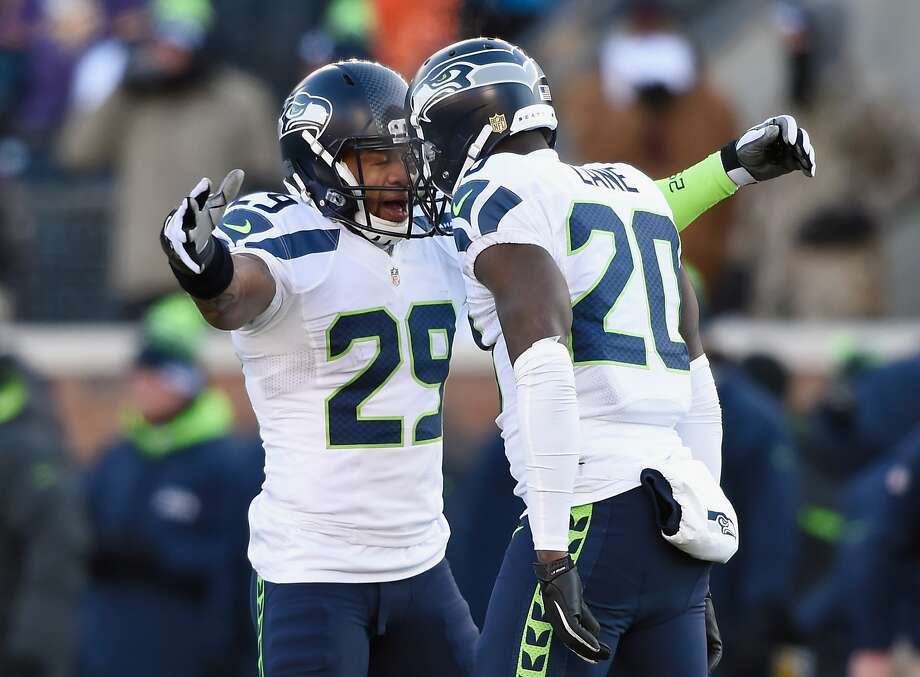 MINNEAPOLIS, MN - JANUARY 10:  Earl Thomas #29 of the Seattle Seahawks and Jeremy Lane #20 celebrate after Lane broke up a pass in the fourth quarter against the Minnesota Vikings during the NFC Wild Card Playoff game at TCFBank Stadium on January 10, 2016 in Minneapolis, Minnesota.  (Photo by Hannah Foslien/Getty Images) Photo: Hannah Foslien, Getty Images
