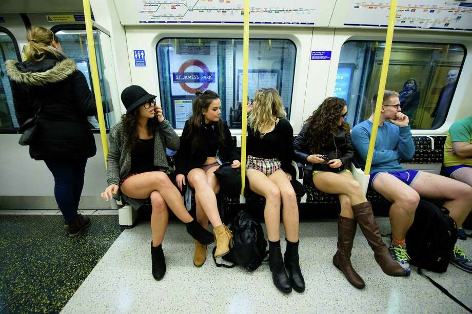 A tradition begun by New York's Improv  Everywhere years ago, residents of cities across the world ride public  transit without pants just for the art of it. Click here to see more photos.  Photo: LEON NEAL, Getty Images / AFP