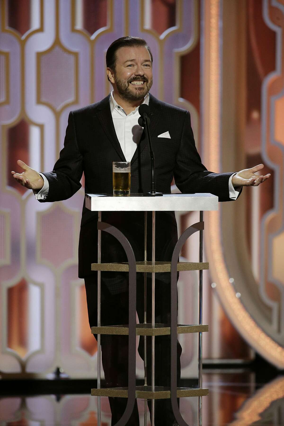 In this handout photo provided by NBCUniversal, Host Ricky Gervais speaks onstage during the 73rd annual Golden Globe Awards at the Beverly Hilton Hotel on Jan. 10, 2016 in Beverly Hills, California.