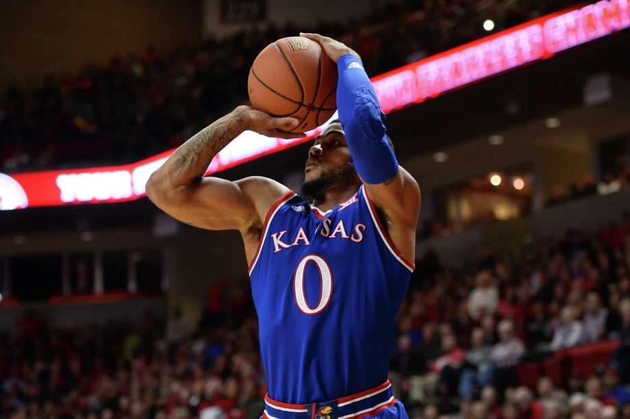LUBBOCK, TX - JANUARY 09: Frank Mason III #0 of the Kansas Jayhawks shoots a jump shot during the game against the Texas Tech Red Raiders  on January 09, 2016 at United Supermarkets Arena in Lubbock, Texas. Kansas won the game 69-59. Photo: John Weast, Getty Images / 2016 Getty Images