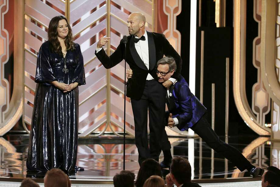 Melissa McCarthy (left), Jason Statham and Paul Feig ham it up onstage at the 73rd annual Golden Globe Awards at the Beverly Hilton Hotel. Photo: Handout, Getty Images