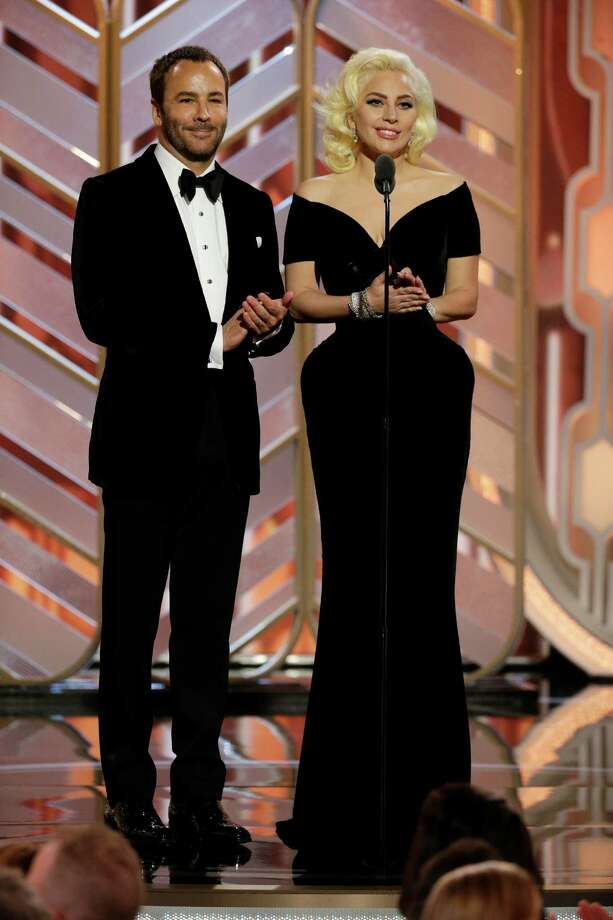 In this image released by NBC, Tom Ford, left, and Lady Gaga present an award at the 73rd Annual Golden Globe Awards at the Beverly Hilton Hotel in Beverly Hills, Calif., on Sunday, Jan. 10, 2016. Photo: Paul Drinkwater, AP / NBC