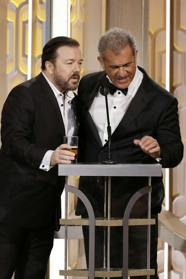 BEVERLY HILLS, CA - JANUARY 10: In this handout photo provided by NBCUniversal,  Host Ricky Gervais and presenter Mel Gibson speak onstage during the 73rd Annual Golden Globe Awards at The Beverly Hilton Hotel on January 10, 2016 in Beverly Hills, California.  (Photo by Paul Drinkwater/NBCUniversal via Getty Images) Photo: Handout, Getty Images