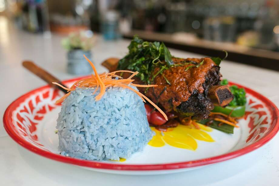 Panang Neua, beef short rib ($22), which is served with blue rice, at Farmhouse Kitchen in the Mission District. Photo: Jen Fedrizzi, Special To The Chronicle