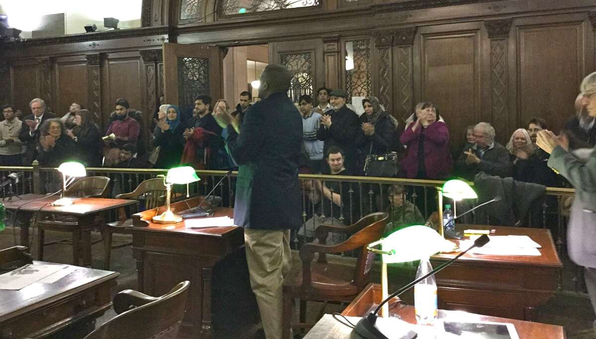 Supporters of the Albany Common Council's anti-Islamophobia resolution responded with a standing ovation after the measure was passed unanimously by the council on Monday night. Speakers in support of the resolution, which was introduced by 10th Ward Councilmember Leah Golby, included Muslim citizens from around the Capital District, community activists, interfaith representatives, and musician Ruth Pelham of Albany, who wrote a song especially for the event. Pelham sang the song during the public comment period, inviting the assembled Common Council and supporters to sing along with her. (Leah Golby)