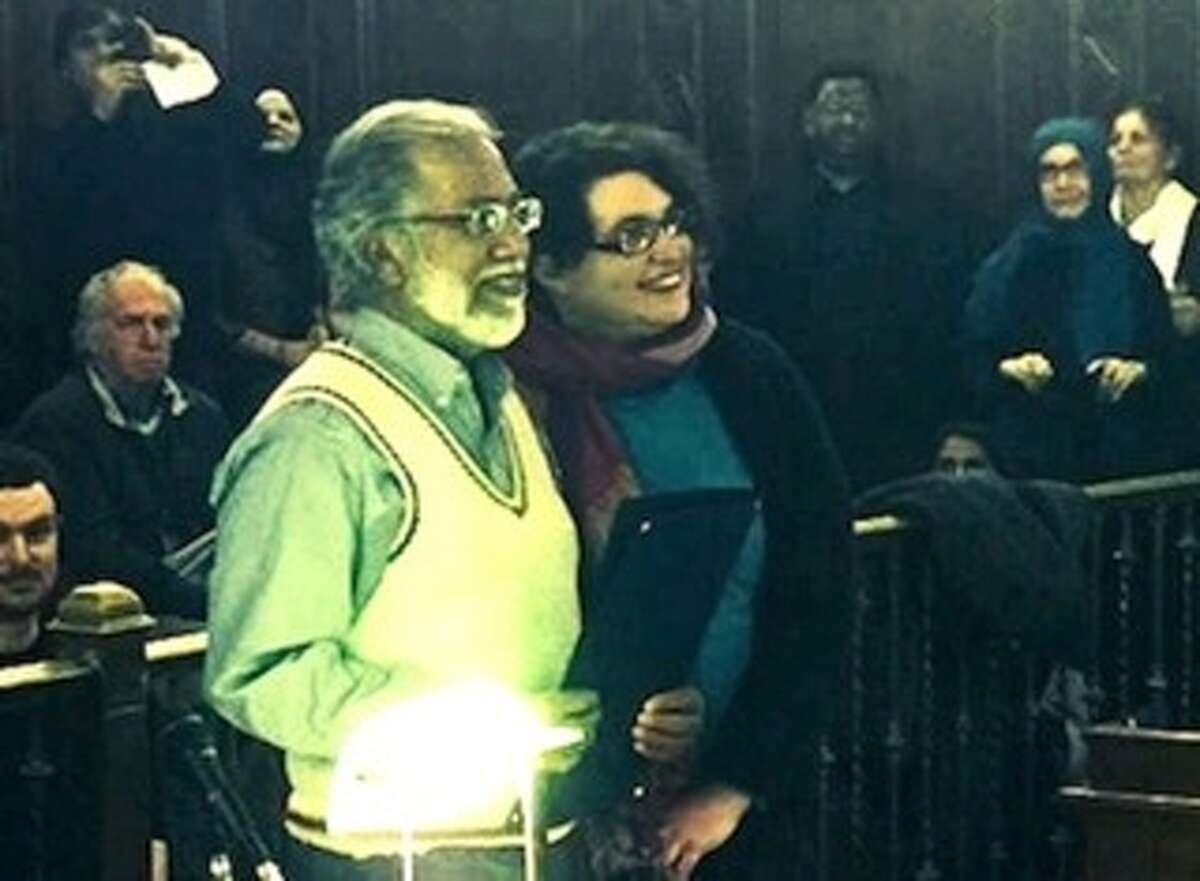 At the January 4 Albany Common Council meeting, Councilwoman Leah Golby, who introduced an anti-Islamophobia resolution that passed unanimously, presented Dr. Shamshad Ahmad, president of Albany's Masjid As-Salam mosque, with a special copy of the resolution. (Photo courtesy of Leah Golby)