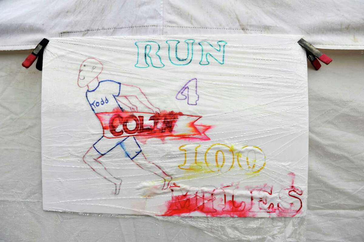 The ink on a sign runs due to rain at the Colonie Central High School track on Sunday, Jan. 10, 2016, in Colonie, N.Y. Todd McAuley was running 100 miles to raise funds for the Wesoloski family. Colin Wesoloksi, a Colonie High School student, just underwent a liver transplant. He suffers from a rare genetic disorder called Alagille Syndrome that compromises many organs, primarily the heart and liver. (Paul Buckowski / Times Union)