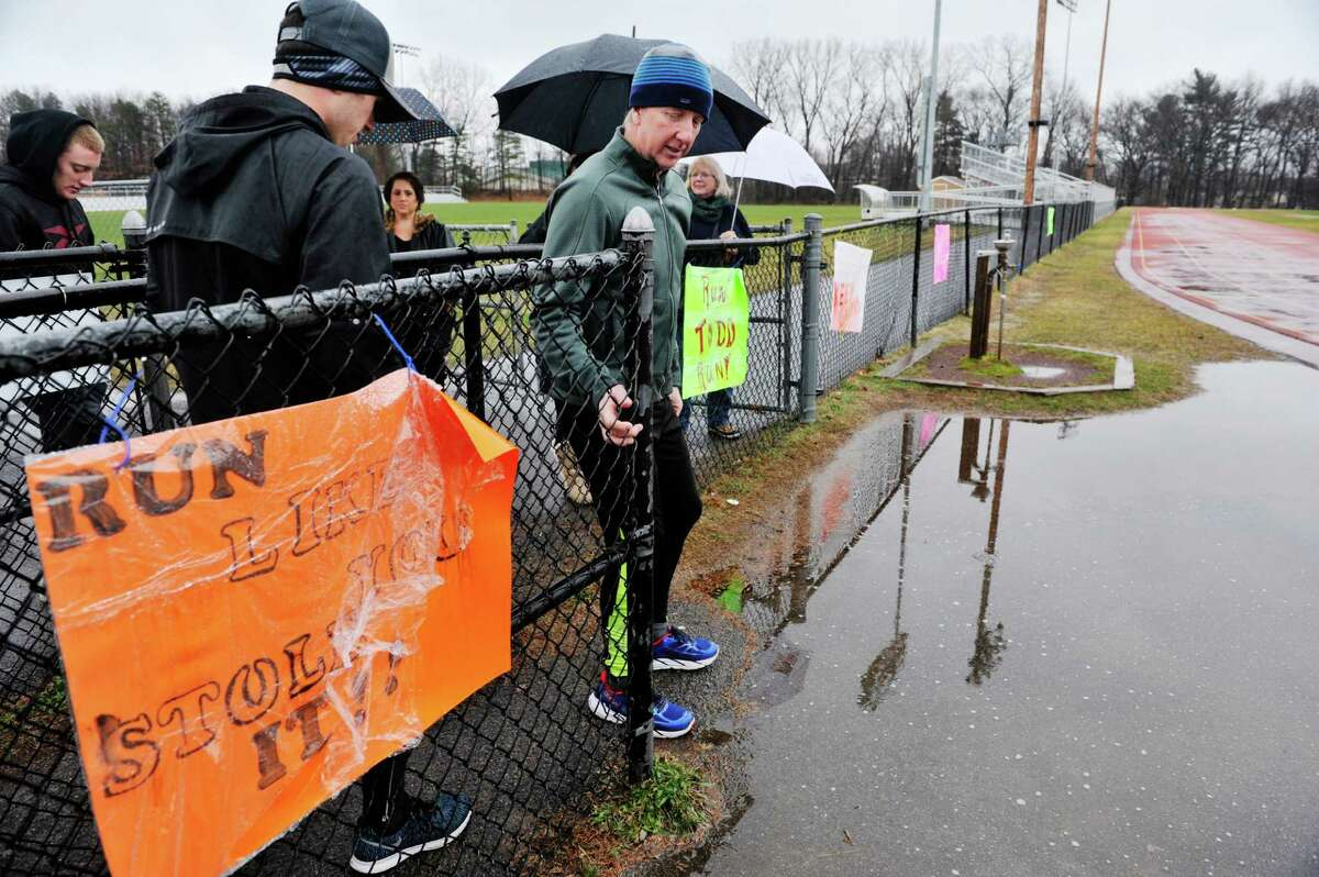 Todd McAuley, right, makes his way back out following a short break at the Colonie Central High School track on Sunday, Jan. 10, 2016, in Colonie, N.Y. McAuley was running 100 miles to raise funds for the Wesoloski family. Colin Wesoloksi, a Colonie High School student, just underwent a liver transplant. He suffers from a rare genetic disorder called Alagille Syndrome that compromises many organs, primarily the heart and liver. (Paul Buckowski / Times Union)
