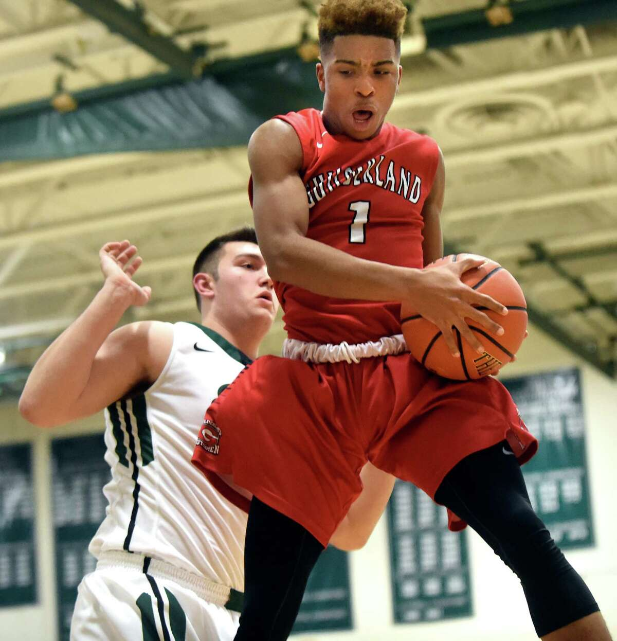 Guilderland's Michael Wine, right, wins the rebound over Shen's Mike Pizziketti during their basketball game on Friday, Dec. 11, 2015, at Shenendehowa High in Clifton Park, N.Y. (Cindy Schultz / Times Union)