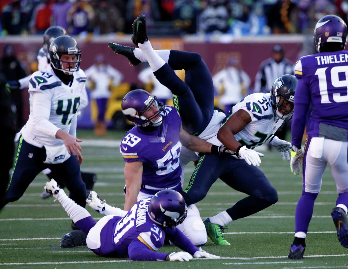 Seattle Seahawks punter Jon Ryan (9) flips over as he run the ball during the first half of an NFL wild-card football game against the Minnesota Vikings, Sunday, Jan. 10, 2016, in Minneapolis. (AP Photo/Jim Mone) ORG XMIT: MNKS124