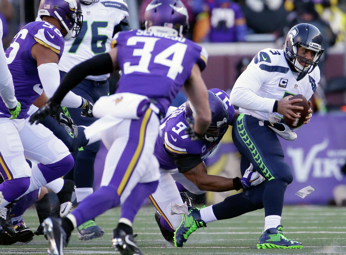 Seattle Seahawks quarterback Russell Wilson (3) is tackled by Minnesota Vikings defensive end Everson Griffen (97) during the first half of an NFL wild-card football game, Sunday, Jan. 10, 2016, in Minneapolis. (AP Photo/Nam Y. Huh) ORG XMIT: MNKS133