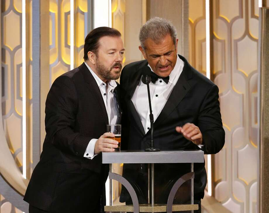 In this image released by NBC, host Ricky Gervais, left, and Mel Gibson appear on stage at the 73rd Annual Golden Globe Awards at the Beverly Hilton Hotel in Beverly Hills, Calif., on Sunday, Jan. 10, 2016. (Paul Drinkwater/NBC via AP) Photo: Paul Drinkwater, Associated Press